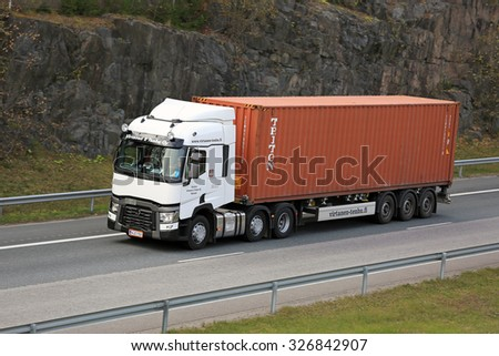 RIIHIMAKI, FINLAND - OCTOBER 10, 2015: White Renault Trucks T hauls an intermodal container. Approx. 90% of all goods are transported in containers. - stock photo