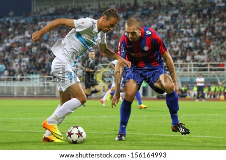 RIJEKA, CROATIA SEPTEMBER 28: soccer derby match NK Rijeka (white) vs. NK Hajduk (blue-red) on September 28, 2013 in Rijeka. - stock photo