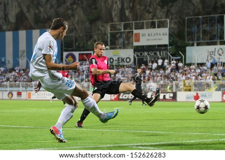 RIJEKA, CROATIA SEPTEMBER 2: soccer derby match NK Rijeka (white) vs. NK Lokomotiva (black-pink) on September 2, 2013 in Rijeka. - stock photo