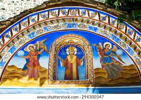Rila, Bulgaria - June, 25, 2015: Wall painting at the entrance of Rila Monastery. The monastery is the largest in Bulgaria and a UNESCO World Heritage site - stock photo
