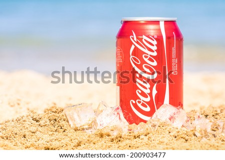 RIMINI, ITALY - MAY 18, 2014: Coca Cola can on ice at the beach. The world famous carbonated soft drink is an incredible best seller in stores, restaurants, and vending machines all over the world. - stock photo