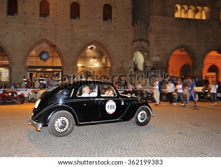 RIMINI (RN), ITALY - MAY 14: A black Lancia Aprilia berlina takes part to the 1000 Miglia classic car race on May 14, 2015 in Rimini (RN). The car was built in 1949. - stock photo