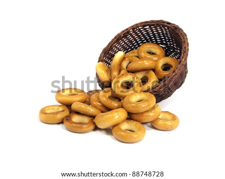 Ring bagels in basket on a white background - stock photo