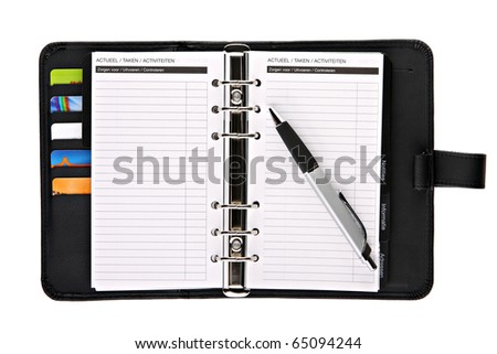 Ring binder organizer planner with pen - stock photo