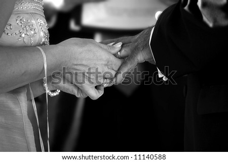 ring ceremony at matured couples wedding - stock photo