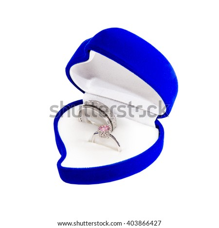 Ring in a blue box in the form of heart - stock photo