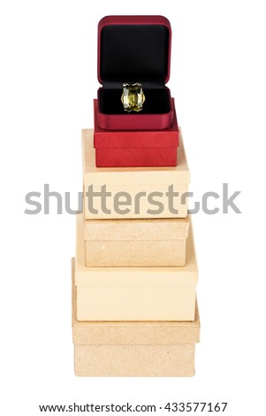 Ring in gift box on a cardboard box tower isolated on a white background - stock photo