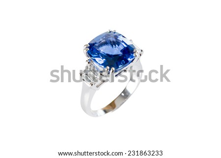 Ring of the jewelry with dark blue sapphire on the White background - stock photo