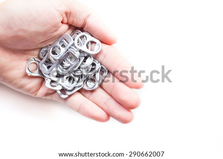 Ring pull aluminum of cans on hand - stock photo
