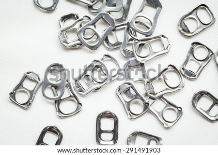 Ring pull aluminum of cans, use make artificial legs - stock photo