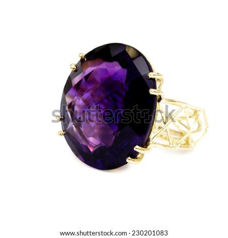 Ring - Purple Precious/Semi-precious Gemstone, Set in Gold, Isolated on White Background - stock photo