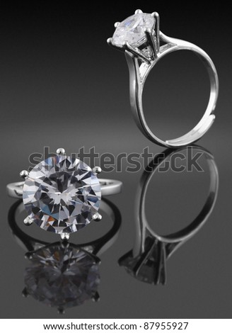 Ring with big diamond on black background - stock photo
