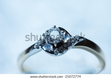 Ring with diamonds in blue tones - stock photo