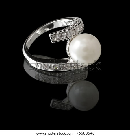 Ring with pearl and diamonds - stock photo