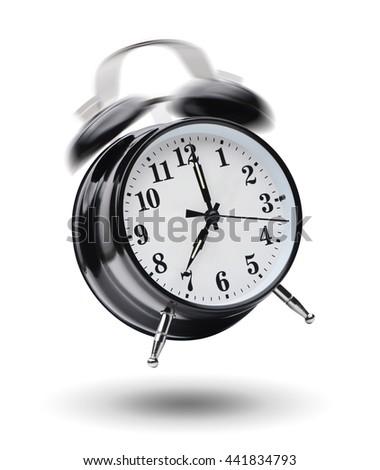 Ringing black alarm clock isolated on white background - stock photo