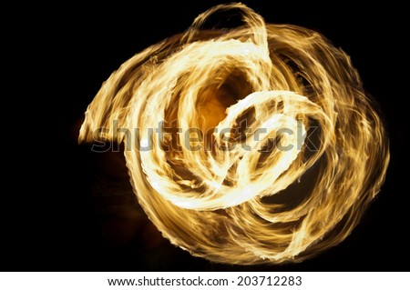 Rings of fire formed during the fire dance performance - stock photo