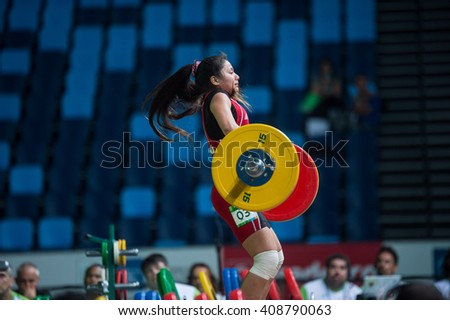 Rio, Brazil - April 4, 2016: CAJAS YOMARA (PER) in the female category during the Aquece Rio Weightlifting Test Event at the Arena Carioca 1 - stock photo
