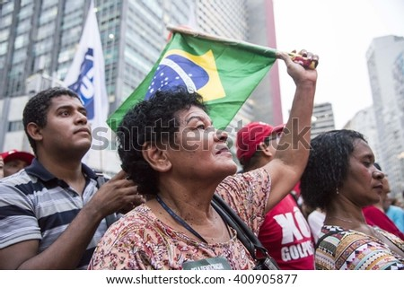 Rio de Janeiro, Brasil - March 31, 2016:  Party workers and social movements are protests in defense of democracy and against the impeachment of President Dilma in the city center in Largo da Carioca - stock photo