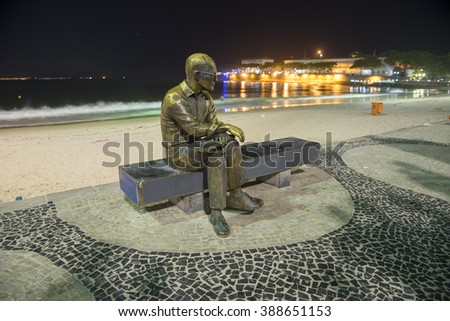 Rio de Janeiro, Brasil - March 09, 2016:  Tourist place - RJ - Copacabana Beach Orla, known as Princess of the Sea, view at night in the south of the city. Statue of the poet Carlos Drummond Andrade - stock photo