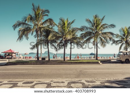 RIO DE JANEIRO, BRAZIL - CIRCA JANUARY  2016: People enjoying the sun on famous Ipanema Beach in Rio de Janeiro. Rio will host 2016 Summer Olympic Games. - stock photo