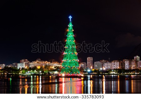 Rio de Janeiro, Brazil - December 22, 2014: Christmas Tree in the middle of Rodrigo de Freitas lagoon. Each year the tree is being built of metal frames and illuminated every night. - stock photo