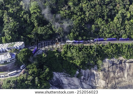 RIO DE JANEIRO, BRAZIL - FEBRUARY 11, 2015: Aerial view of car accident on avenida Niemeyer between Rio de Janeiro and San Conrado.Smoke is coming from burning car, road is closed for traffic. - stock photo