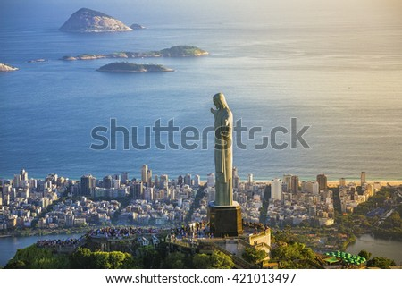 RIO DE JANEIRO, BRAZIL - FEBRUARY 2016: Aerial view of Christ The Redeemer Statue with people visiting Corcovado Hill. View from helicopter through Ipanema Beach. - stock photo