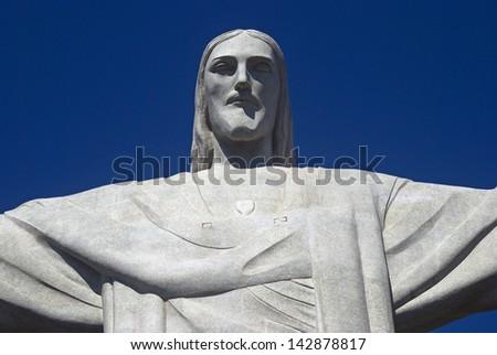 RIO DE JANEIRO, BRAZIL - FEBRUARY 2 : Christ Statue at 2 February 2013, Rio de Janeiro, Brazil. The symbol of Rio de Janeiro is standing on Corcovado. - stock photo