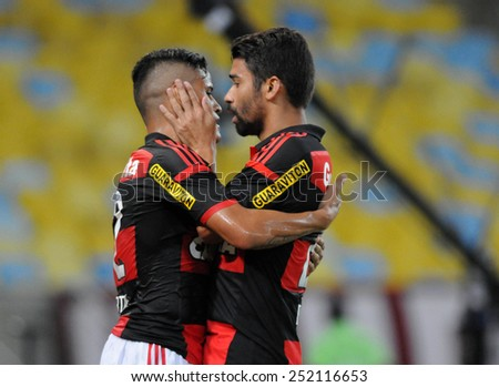 RIO DE JANEIRO, BRAZIL - FEBRUARY 11, 2015:  Football match  between Flamengo and Cabofriense, during the Carioca Football Championship. - stock photo