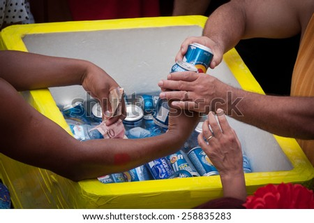 RIO DE JANEIRO, BRAZIL - FEBRUARY 14, 2015: Man selling beer in the street during Carnival. During big events street sellers make thousands of dollars within few days. - stock photo