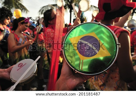 RIO DE JANEIRO, BRAZIL - FEBRUARY 08, 2013: Street Carnival in Rio de Janeiro, crowd of people celebrate on the street with Blocos, individual groups who plan the parties with bands and samba music. - stock photo
