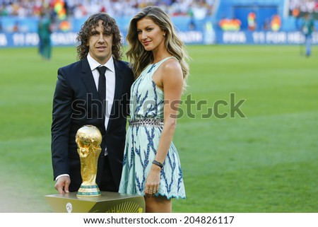 RIO DE JANEIRO, BRAZIL - July 13, 2014: Former player Puyol and model Bundchen with the Trophy before the 2014 World Cup Final game between Argentina and Germany at Maracana Stadium. NO USE IN BRAZIL. - stock photo
