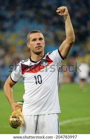 RIO DE JANEIRO, BRAZIL - July 13, 2014: Podolski of Germany celebrates with the Trophy winning the 2014 World Cup Final game between Argentina and Germany at Maracana Stadium. NO USE IN BRAZIL. - stock photo
