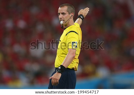 RIO DE JANEIRO, BRAZIL - June 18, 2014: Head referee Mark Geiger during the World Cup Group B game between Spain and Chile at Maracana Stadium. NO USE IN BRAZIL - stock photo