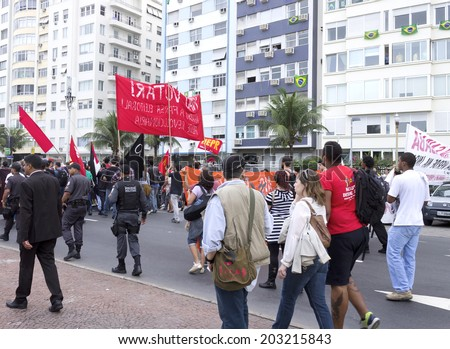 RIO DE JANEIRO, BRAZIL-June 23, 2014: Manifestation popular with domestic and international issues, followed closely by military police and press releases on Atlantic Avenue - Copacabana  - stock photo