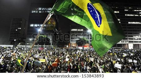 RIO DE JANEIRO, BRAZIL - JUNE 20, 2013-Thousand of demonstrators marches to the Rio de Janeiro city hall to protest against government. on 06/20/2013, in Rio de Janeiro, Brazil. - stock photo