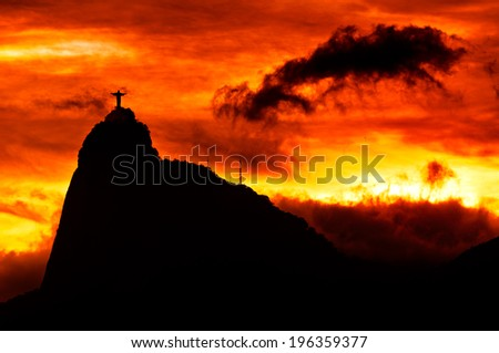 RIO DE JANEIRO, BRAZIL - MARCH 30: The famous Rio de Janeiro landmark - Christ the Redeemer statue on Corcovado mountain on 30 March 2014, shot during beautiful sunset. - stock photo
