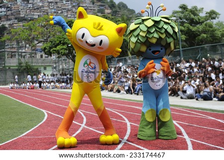 RIO DE JANEIRO, BRAZIL - November 24, 2014 - Mascots of the Olympic and Paralympic Games of Rio 2016 in their first public appearance at the Olympic Gymnasium Juan Antonio Samaranch, in Santa Teresa - stock photo