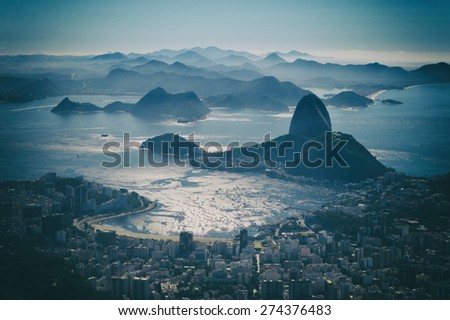 Rio de Janeiro Brazil scenic overlook view of the dramatic city skyline with shining Botafogo Bay and Sugarloaf Mountain - stock photo