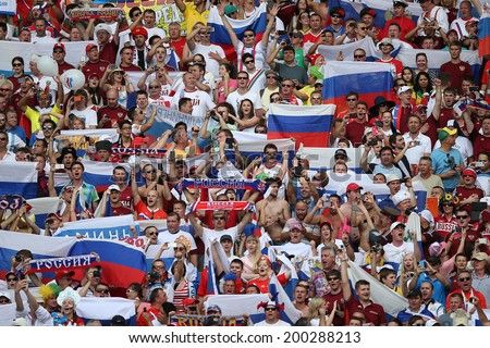 RIO DE JANEIRO - JUNE 22: Russian  fans cheering on the FIFA World Cup 2014 game between Russia and Belgium at the Maracana stadium on June 22, 2014 in Rio De Janeiro, Brazil. No Use in Brazil. - stock photo