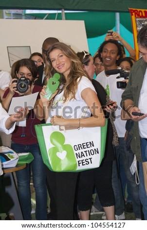 RIO DE JANEIRO - JUNE 04: Top Model Gisele Bundchen exhibiting trophy received in the ecological event Green Nation Fest. Event Green Nation Fest,June 04, 2012 in Rio de Janeiro, Brazil - stock photo
