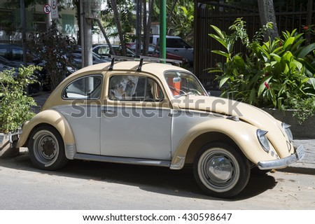RIO DE JANEIRO - MARCH 28, 2016: Classic Volkswagen Type 1 Beetle, known locally as a Fusca, parked on a quiet street in the upscale residential neighborhood of Ipanema. - stock photo