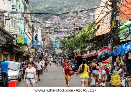 RIO DE JANEIRO - MARCH 5, 2014: Rocinha is the largest favela in Brazi. About 80000 people live in Rocinha, making it the most populous favela in Rio de Janeiro. - stock photo