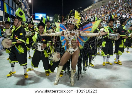 RIO DE JANEIRO, RJ /BRAZIL - FEBRUARY 18, 2012: Samba School parade in Sambodromo. Estacio School. Dancer during the festival on february 18, 2012 in Rio de Janeiro. - stock photo
