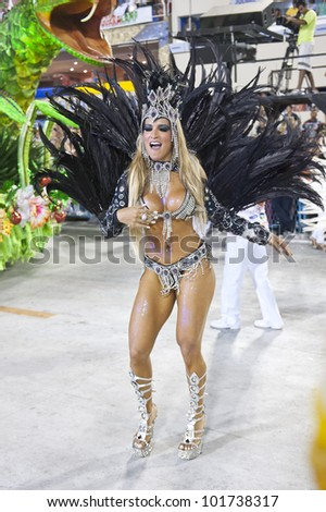 RIO DE JANEIRO, RJ, BRAZIL - FEBRUARY 19, 2012: Samba School parade in Sambodromo. Unidos do Viradouro School. Dancer during the festival on february 19, 2012 in Rio de Janeiro - stock photo