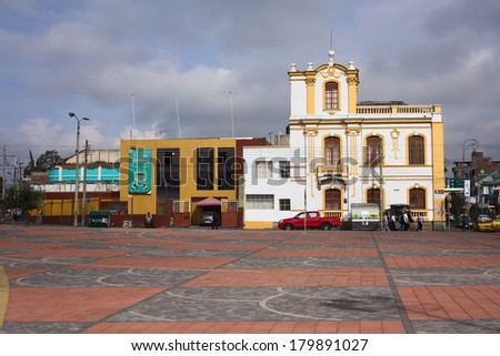 RIOBAMBA, ECUADOR - FEBRUARY 16, 2014: The square behind the train station of Riobamba, with view onto the buildings of the Calle Juan Lavalle on February 16, 2014 in Riobamba, Ecuador  - stock photo