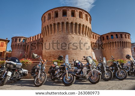 """RIOLO TERME, ITALY - SEPTEMBER 22: american motorbikes Harley Davidson parked near the medieval castle during the motorcycle rally """"Sangiovese tour"""" on September 22, 2013 in Riolo Terme (RA) Italy - stock photo"""