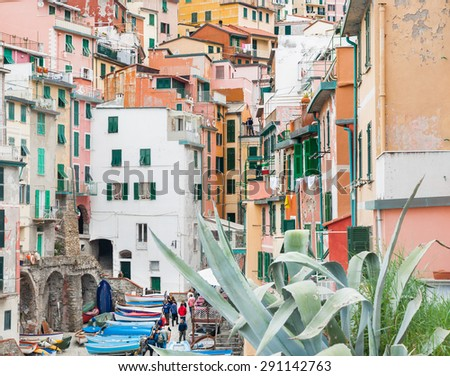 RIOMAGGIORE, ITALY-APRIL 23: Cinque Terre, hillside village stacked homes different colors down to boats where locals and tourists wander amongst picturesque setting,April 23,2015, Riomaggiore, Italy - stock photo