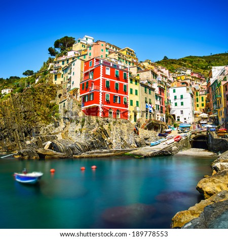Riomaggiore village on cliff rocks and sea at sunset., Seascape in Five lands, Cinque Terre National Park, Liguria Italy Europe. Long Exposure - stock photo
