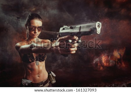 riot girl aiming a gun close up - stock photo